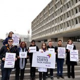 Task Force staff with signs protesting HHS at their DC building
